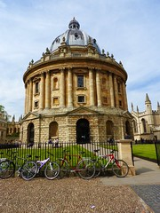 Radcliffe Camera (heathernewman) Tags: uk england building green grass stone architecture golden university bikes bluesky oxford radcliffecamera pillars cobbles oxfordshire