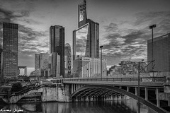 Quartier de La Dfense (karmajigme) Tags: city travel bridge blackandwhite paris monochrome architecture landscape nikon noiretblanc ladfense