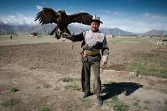 Eagle hunter (Lil [Kristen Elsby]) Tags: canon5dmarkii centralasia kyrgyzstan travelphotography bokonbaevo bokonbaeyevo kyrgyz eaglehunter talgar eaglehunting eagle goldeneagle issykkul portrait portraiture environmentalportraiture falconry topf25 topv1111