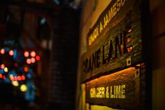 Crane Lane Sign (i.begala) Tags: art sign night photography 50mm pub dof bokeh crane cork lane 095 mitakon