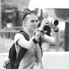 At the Cup Parade 1 (R.A. Killmer) Tags: people blackandwhite monochrome penguins concentration women photographer candid working thoughtful parade professional event