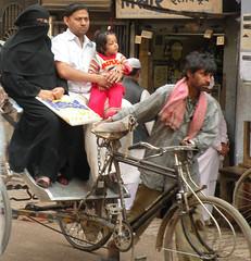 Ricksha (bokage) Tags: street family india man child hijab varanasi wife niqab ricksha benares uttarpradesh