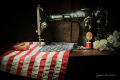 The Hands That Build America (JGo9) Tags: flowers stilllife usa lightpainting thread america vintage stars us antique stripes flag thimble singer pincushion thepast starsandstripes oldglory sowingmachine canont1i