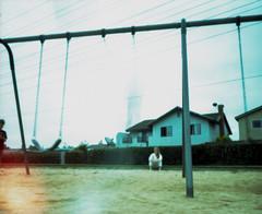 Swinging at Childhood's End (geraldfigal) Tags: iso200 xpro sara crossprocess swing pinhole lightleak henry 6x7 expired ektachrome philip
