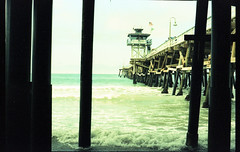 San Clemente, CA - 35mm cross processed slide film (dakotabrinkert) Tags: ocean california ca light shadow sea color colour art film beach sc beauty cali 35mm vintage dark photography gold golden pier photo cool xpro crossprocessed sand pretty waves fuji cross crossprocess south awesome grain salt perspective wave southern socal salty grainy oceans southerncalifornia process sanclemente processed dakota seas saltwater goldenstate brinkert dakotabrinkert