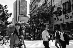 Tokyo Reflections: The look (Richard Buttrey) Tags: bw woman film monochrome look japan 35mm japanese tokyo fuji crossing shibuya scan summicron neopan presto leicamp