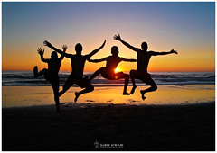 There is nothing better than jumping up and feeling free, away from all the restrictions of life !! (Karim Achalhi) Tags: blue sunset sky orange sun black beach water colors silhouette yellow canon person jump jumping hand feel free morocco asilah feling 550d