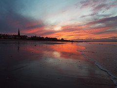 Painting wi light on Porty Beach (Lee Kindness) Tags: sunset sea sky orange reflection beach water silhouette clouds scotland seaside sand edinburgh waves unitedkingdom dusk wideangle panasonic spire portobello firthofforth joppa zd l10 714mm