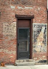 Ghost Door (podolux) Tags: door nikon doors bricks roadtrip doorway brickbuilding 2012 paintedwall ghostsign ghostsigns paintedsign ghostad paintedad d5100 august2012 nikond5100 snapseed nikkordx1855vr