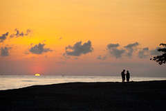 Jemeluk, Amed, Bali (EdBob) Tags: ocean morning travel friends red people bali woman sun holiday man hot beach water yellow sunrise indonesia fun island happy person sand couple asia paradise married indianocean romance tropical romantic humid balinese blacksandbeach islandparadise eastbali colorphotoaward edmundlowe earthasia jemeluk edlowe edmundlowe allmyphotographsarecopyrightedandallrightsreservednoneofthesephotosmaybereproducedandorusedinanyformofpublicationprintortheinternetwithoutmywrittenpermission edmundlowephotography edmundlowestudiosinc