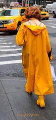 Yellow is the new black (308-366) (nikkorglass) Tags: nyc woman usa ny newyork rain yellow boots may yellowcab rubber raincoat wellies 2009 gul 308 thebigapple yellowisthenewblack 308366 366project