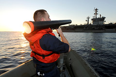 A Sailor uses a simulated rocket launcher. (Official U.S. Navy Imagery) Tags: heritage america liberty freedom commerce unitedstates military navy sailors fast pacificocean worldwide tradition usnavy protect deployed flexible onwatch beready defendfreedom warfighters nmcs chinfo sealanes warfighting preservepeace deteraggression operateforward warfightingfirst navymediacontentservice