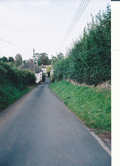 Newton St Cyres.       Looking down Pump Street towards the village. (~Mike & Mary's Photography~) Tags: trees houses windows england house green nature grass outdoors photography holidays shadows village path roofs stonewall roads thatchedroof shrubs chimneys thatchedcottage chimneypots filmphotography newtonstcyres takenonacanont70camera