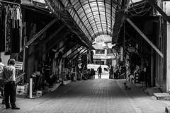 The old bazaar / Loneliness is a curse (zgr Grgey) Tags: street bw dog shop 50mm nikon candid silhouettes cobblestone d750 denizli 2016 kaleii