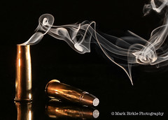 Vetterli Smoking Gun Shell (Mark Birkle) Tags: life old hot reflection photo gangster still cool key warm mood moody shot image antique smoke low rifle picture style best smoking smokey radical curl brass coolest thick curling casing cartridge 1870 vetterli