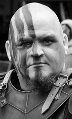 War Paint (wyojones) Tags: texas toddmission texasrenaissancefestival trf renaissance renfest faire festival fest barbarian leather armour bald nohair haircut eye eyes look mean fierce warrior expression usa portrait outdoor wyojones depthoffield