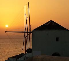 Sunset in Oia,Santorini (JHHALL2010.) Tags: greece oia sky sun sea windmill holiday vacation island