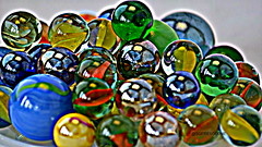 Marbles. (SG Fresolone) Tags: blue red orange black color colour macro green yellow circles lips round marbles d5100