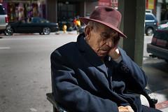 Los Angeles Street (Chris Camargo) Tags: street old sleeping man male face hat 35mm la pain nikon downtown sad buttons coat sidewalk lamppost elderly thinking depressed fedora f2 fullframe nikkor fx wrinkles ff gentleman losangelesst d700