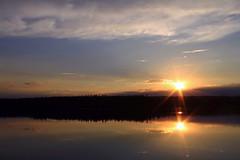 Sunset on a beautiful wilderness pond (Orion 2) Tags: sunset sun canada nature reflections landscape evening pond dusk nopeople loons sunburst wilderness canoeing boreal newfoundlandandlabrador seenfromtheportagebeforeleaving roughforestaccessroad sightedanowl