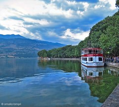 n Pamvotis lake, Ioannina (amalia lam) Tags: blue trees sky white green water colors canon reflections boats photography pier lakes cities panoramas greece environment towns clounds nationalgeographic capitals distortions ioannina panoramicphotos epirus pamvotislake