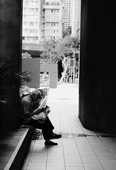 (rainie_ho) Tags: blackandwhite man hongkong reading mono newspaper chinese streetphotography greyscale rainieho
