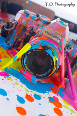 Crayola4 (to.photography) Tags: camera pink blue orange color yellow photography colorful purple magenta olympus strap cannon wax crayon melted oldcamera crayola owens meltedcrayon tophotography taylorwowens
