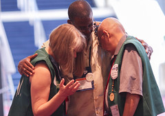 Volunteers pray during General Conference (United Methodist News Service) Tags: portland volunteers pray praying generalconference gc2016