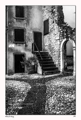 Which Way (jeremy willcocks) Tags: door windows blackandwhite landscape mono europe arch steps flowerpot cobbles jeremywillcocks fujix100t wwwsouthwestscenesmeuk whichwayitaly