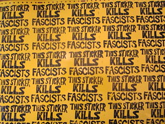 get your protest on (andres musta) Tags: woodie guthrie folk protest this machine kills fascists sticker block print andres musta stickers stickerart zas zombie art squad zombieartsquad adhesive andresmusta slaps