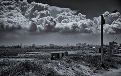 Urban Storm, Seen from the Styx.jpg (Mookalafalas) Tags: street city blackandwhite clouds seaside asia country apocalypse taiwan hut drama dramaticclouds canon24105 canon5d3