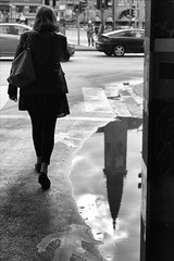 R0013381.tif (Sigfrid Lundberg) Tags: street people woman reflection copenhagen denmark puddle streetphotography puddles danmark reflexion kbenhavn kpenhamn zm vesterbrogade pl spegling kvinna cityhallsquare vattenpuss vattenpl hovedstaden csonnart1550 zeiss50mmf15csonnarzm