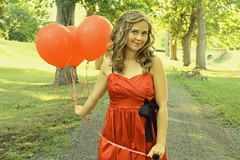 Bitsy (aevanse) Tags: trees light red summer portrait girl grass smiling standing vintage balloons happy evening dress path pastel bow curlyhair reddress redballoons