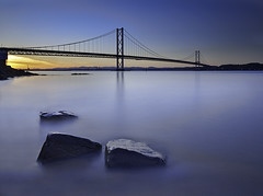 Forth Road Bridge (ajnabeee) Tags: road longexposure bridge blue sunset sea seascape motion blur water scotland rocks edinburgh traffic dusk scottish forth filter vehicle firthofforth queensferry gloaming southqueensferry forthroadbridge 10stop shahbazmajeed