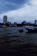 Olympic rings (frankie091) Tags: city blue sunset sky building london water vertical thames skyline clouds contrast canon vintage buildings river dark evening boat cool gloomy awesome hipster olympics dope sick edit londoncity cityoflondon london2012 600d canon600d verticalphotography
