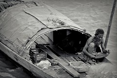 Cigarette break (Ersin Demir) Tags: travel people blackandwhite bw man composition boat fisherman asia cambodia outdoor cigarette thoughtful oldman phnompenh mekong cigarettebreak mekongriver nikon70300mm nikond5100