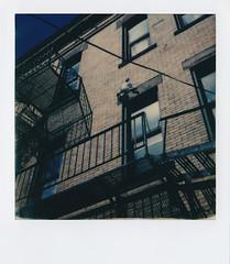 s. millvale (Lisa Toboz) Tags: polaroid morninglight fireescape brokendoll instantfilm gen3 impossibleproject garfieldpittsburgh