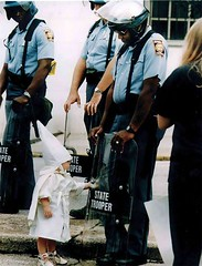 A young boy in KKK robes sees his reflection in a riot shield held by an African-American state trooper (1992) [1024 x 1342] #HistoryPorn #history #retro http://ift.tt/23lqARY (Histolines) Tags: boy trooper reflection history by riot state young x an retro his timeline africanamerican shield 1992 held kkk sees robes 1024 1342 vinatage a historyporn histolines httpifttt23lqary