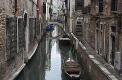 Venice side canal (Ranyan23) Tags: bridge venice windows water boats canal shutters