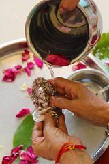 Pooja_faith (namita t) Tags: home rose petals god faith ganesh idol pooja entry ganapati cleanse