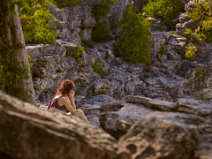 Contemplation (StephenCaissiePhoto) Tags: trees summer portrait woman sunlight ontario nature outdoors rocks warm alone sitting afternoon cove candid amphitheatre thoughtful sunny backlit contemplative phaseone p30 captureone