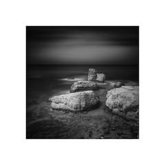 Sea Caves (Furious Zeppelin) Tags: sea bw white black nikon cyprus caves le d80 furiouszeppelin fz