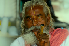 smoking the chillum (Handheld-Films) Tags: travel portrait people india intense eyes asia faces documentary smoking portraiture chillum reportage ruralrajasthan indianportraits chillumpipes