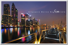 singapore (fiftymm99) Tags: bridge sea reflection building beach water skyline marina river lights bay boat seaside singapore cityscape cbd singaporeriver marinabay fiftymm nikond300 marinabaysand fiftymm99 gettyimagessingaporeq2