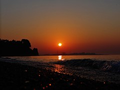 Sunrise (lil red5 ) Tags: sun ontario canada hot colour beach wet water silhouette june sunrise outside outdoors rocks waves colours bright sony wave sunny reflect scarborough lakeontario relfections 2012 rollingin pickeringpowerplant sonydschx100v