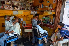 Barber.  Hampi (Claire Pismont) Tags: travel color colour yellow colorful asia earth barber asie karnataka couleur hampi viajar travelphotography earthasia pismont clairepismont