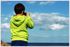 the Boy (*Kicki*) Tags: 2012 boy green blue photographer child sea sky clouds person camera grisslehamn sweden roslagen väddö horizon people