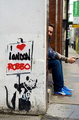 I Love London & Brian (peterotoole) Tags: street uk family blue red portrait building london tattoo corner stars graffiti shoes europe heart unitedkingdom britain pavement banksy barbican jeans handheld denim british puma dslr placard eastlondon iphone waitrose chiswellstreet d7k teamrobbo ratblack rangedynamic ec1y4sa