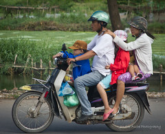 Five on a bike and one falling asleep! (2 photos) (NettyA) Tags: road travel family boy people children parents asia vietnamese child five south vietnam falling motorbike southeast asleep eos550d