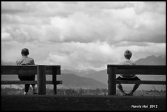 Keeping Some Distance Is Good - Terra Nova N10321e (Harris Hui (in search of light)) Tags: family portrait sky bw canada monochrome vancouver clouds work observation mono blackwhite nikon couple bc candid strangers streetphotography marriage richmond digitalbw serendipity benches relationships privacy manandwoman d300 candidportrait terranova candidphotography surprises streetcandid terranovaruralpark nikonuser nikond300 reallifemoments harrishui vancouverdslrshooter keepingsomedistanceisgood observeourlife youneverknowwhatyouwillgetwithyourcamerabytheendofday